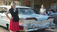 I started working at the Portage A&W when I was 14, and last summer had the opportunity to visit it for Cruise Night. In this picture, you can see my twin sister, Emma, and myself dressed up as carhops while classic cars visit to relive their glory days.
